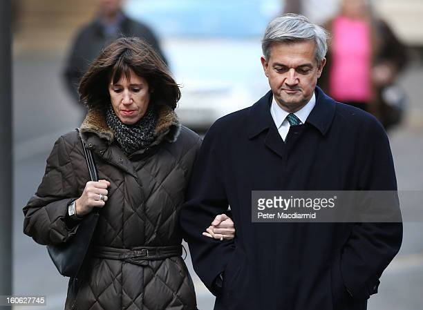 Former Cabinet Minister Chris Huhne arrives at Southwark Crown Court with Carina Trimingham on February 4 2013 in London England Huhne and his exwife...