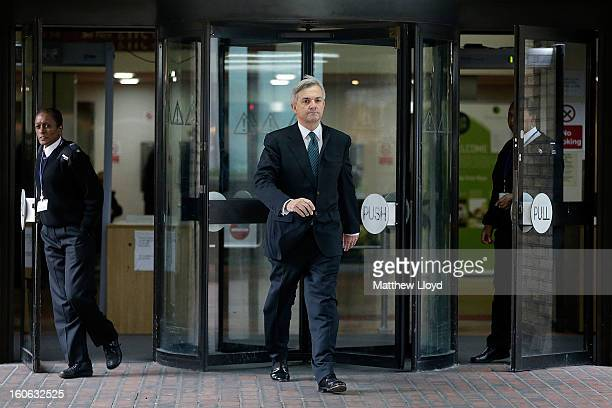 Former Cabinet Minister Chris Huhne leaves Southwark Crown Court on February 4 2013 in London England Huhne and his exwife Vicky Pryce are on trial...