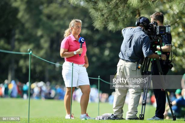 Former caddie Fanny Sunesson looks on during a practice round prior to the start of the 2018 Masters Tournament at Augusta National Golf Club on...
