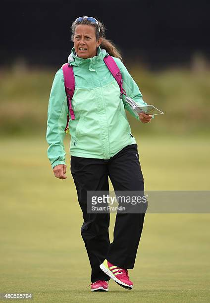 Former caddie Fanny Sunesson walks the course with Sir Nick Faldo as he plays a practice round ahead of the 144th Open Championship at The Old Course...