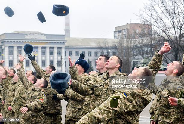 Former cadets of the military faculty of National Technical University throw their hats on February 28 2015 during a graduation ceremony in...