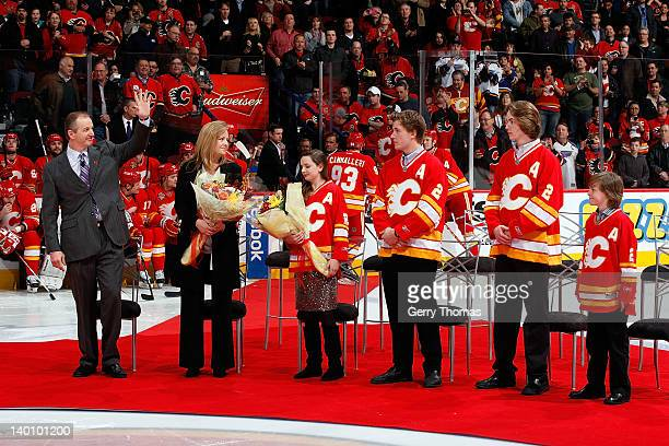 Former Calgary Flame Al MacInnis is honoured as the first inductee of the Forever a Flame program before the game between the Calgary Flames and the...