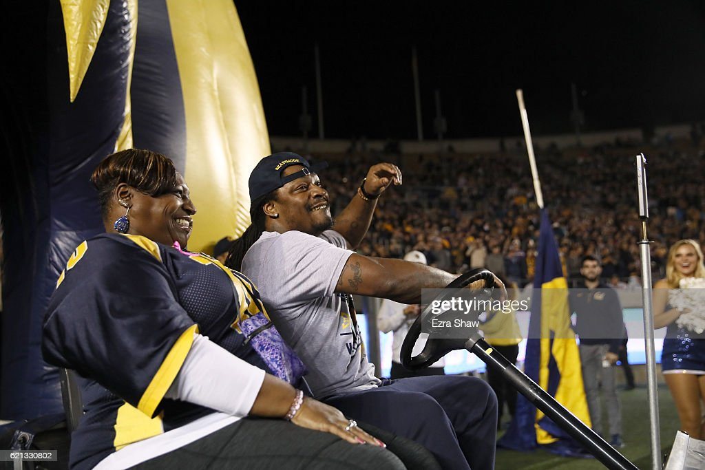 Former California Golden Bears and NFL running back Marshawn Lynch rides in to the stadium with his mother, Delisa Lynch, before the California Golden Bears game against the Washington Huskies California Memorial Stadium on November 5, 2016 in Berkeley, California.