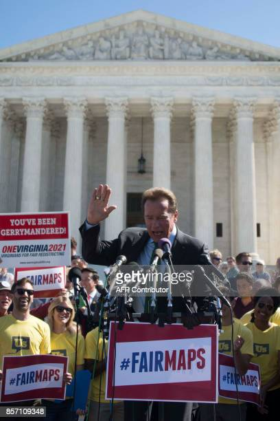 Former California Governor and actor Arnold Schwarzenegger speaks outside the US Supreme Court in Washington DC October 3 after the court heard...