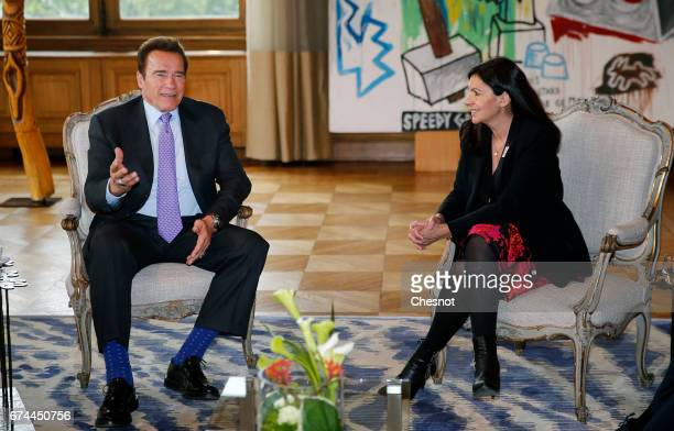 Former California Governor and founder of the Regions of Climate Action Arnold Schwarzenegger meets the Mayor of Paris Anne Hidalgo on April 28 2017...