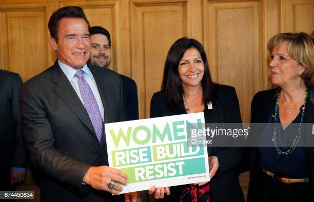 Former California Governor and founder of the Regions of Climate Action Arnold Schwarzenegger poses with the Mayor of Paris Anne Hidalgo on April 28...