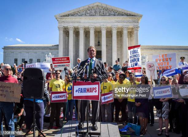 Former California Governor Arnold Schwarzenegger addresses protestors in front of the Supreme Court after the Justices hear arguments on...