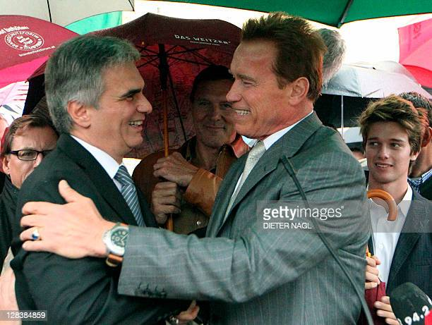 Former California Governor Arnold Schwarzenegger and Austrian Chancellor Werner Faymann smile as his son Patrick looks on October 7 2011 during the...