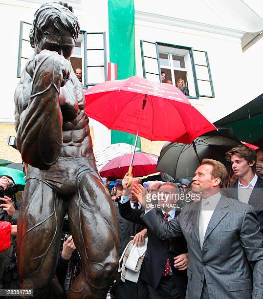 Former California Governor Arnold Schwarzenegger and his son Patrick attend on October 7 2011 the unveiling of a statue during the opening of Arnold...