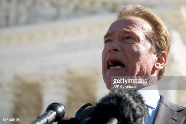 Former California Governor Arnold Schwarzenegger speaks outside the US Supreme Court in Washington DC October 3 after the court heard arguments...