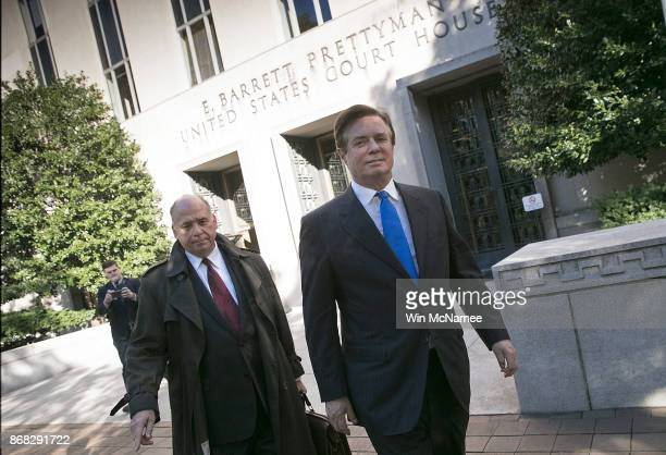Former campaign manager for US President Donald Trump Paul Manafort leaves US District Court after pleading not guilty following his indictment on...