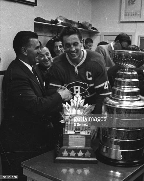 Former Canadien Maurice Richard congratulates Jean Beliveau of the Montreal Canadiens on winning the Stanley Cup Trophy and the Conn Smythe Trophy...