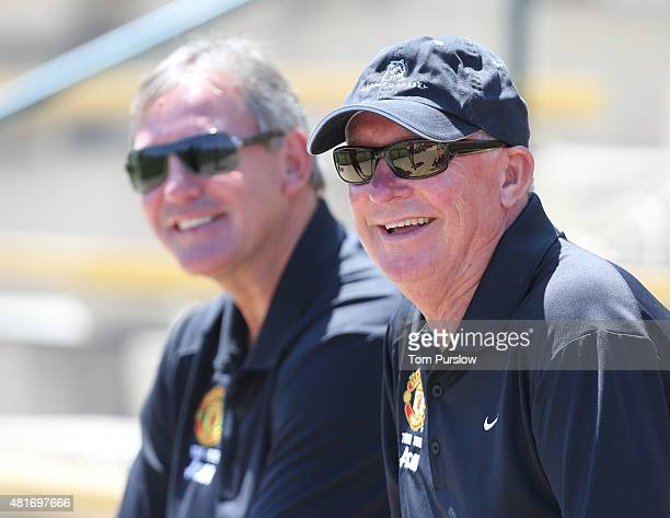 Former captain Bryan Robson and former manager Sir Alex Ferguson of Manchester United watch during a first team training session as part of their...