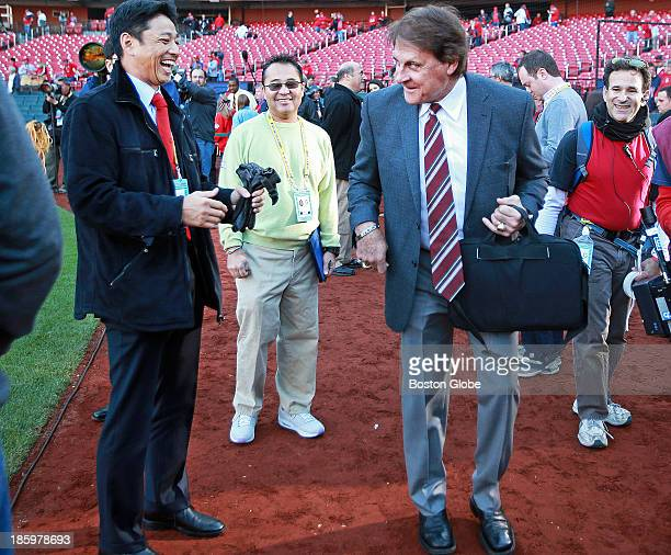 Former Cardinals manager Tony LaRussa right who was the skipper in 2004 when the Red Sox beat his team in the World Series brought a smile to the...