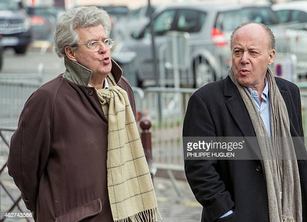 Former Carlton Hotel publicist Rene Kojfer and his lawyer Hubert Delarue arrive at the Lille courthouse northern France on February 4 2015 The first...