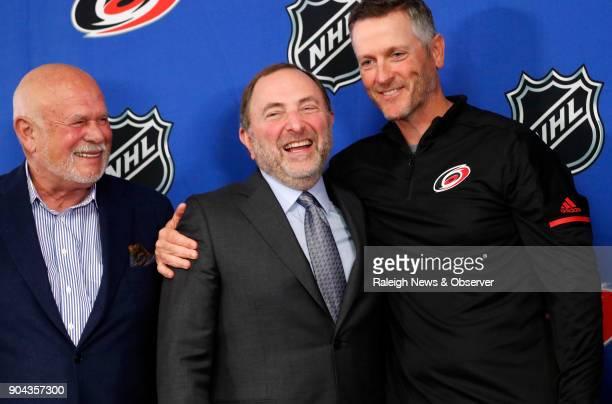 Former Carolina Hurricanes majority owner Peter Karmanos left NHL commissioner Gary Bettman center and Thomas Dundon new Hurricanes majority owner...