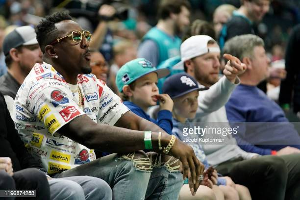 Former Carolina Panthers player Thomas Davis looks on during the first quarter during the game between the Charlotte Hornets and the Boston Celtics...