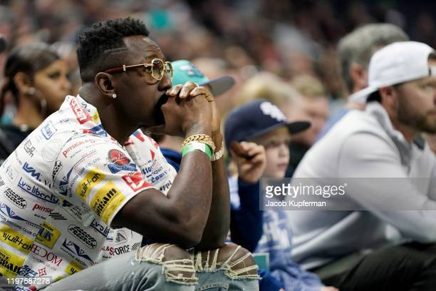 Former Carolina Panthers player Thomas Davis watches the game between the Charlotte Hornets and the Boston Celtics at Spectrum Center on December 31...