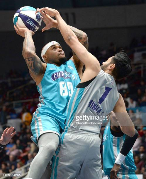 Former Carolina Panthers wide receiver Steve Smith left drives to the basket for a shot against Hasan Minhaj right during the NBA AllStar Celebrity...