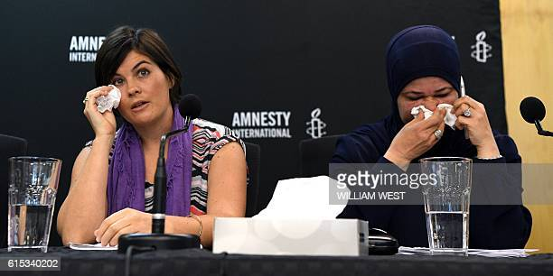 A former case manager on the island nation of Nauru Sandra Bartlett fronts a Amnesty International press conference in Sydney on October 18 with...