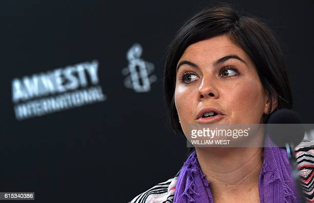 A former case manager on the island nation of Nauru Sandra Bartlett fronts a Amnesty International press conference in Sydney on October 18 2016...
