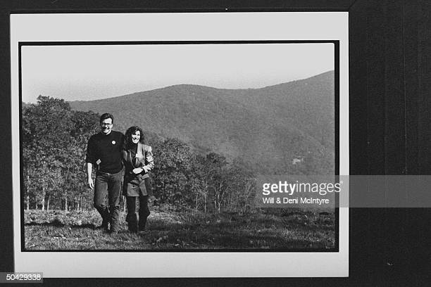 Former cast member of the TV show The Waltons Judy NortonTaylor w her husband Randy Apostle walking arminarm in wooded area during the opening of the...