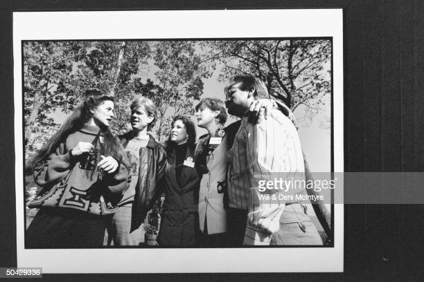 Former cast members of the TV show The Waltons Kami Cotler Jon Walmsley Judy NortonTaylor Mary McDonough and Eric Scott standing together outside...