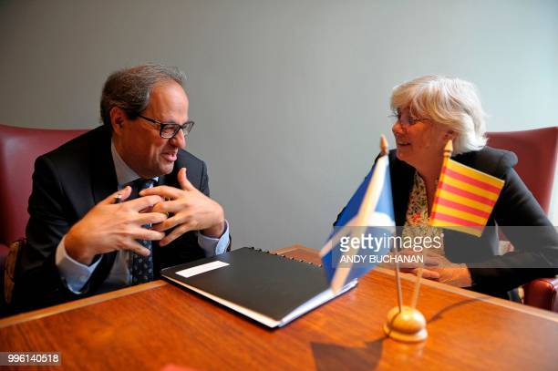 Former Catalan education minister Clara Ponsati and Calatan President Quim Torra chat before holding a press conference in Edinburgh on July 11 2018...