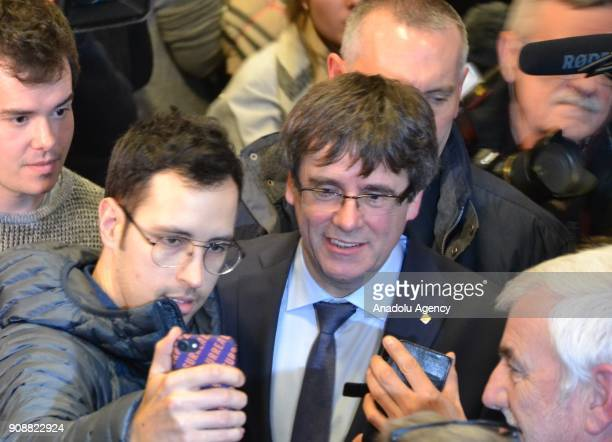 Former Catalan leader Carles Puigdemont poses for a photo with students as he attends a panel at University of Copenhagen in Copenhagen Denmark on...