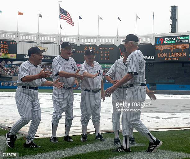 Former catcher and manager Yogi Berra prepares to jump into the arms of former pitcher Don Larsen during Old Timers Day on June 24 2006 at Yankee...