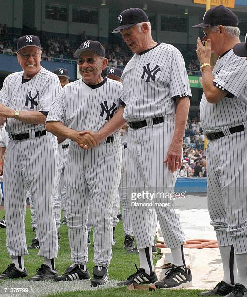 Former catcher and manager Yogi Berra shakes the hand of former pitcher Don Larsen both of the New York Yankees during Old Timers Day on June 24 2006...