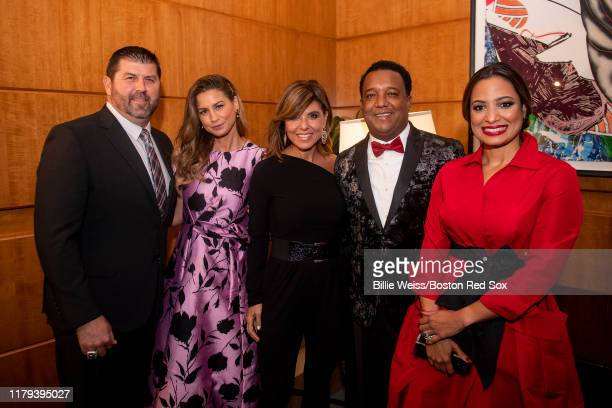 Former catcher Jason Varitek of the Boston Red Sox and his wife Catherine anchor Maria Stephanos and former pitcher Pedro Martinez of the Boston Red...