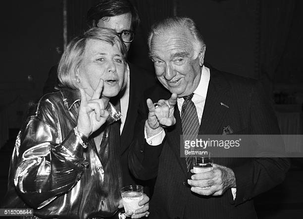 Former CBS news anchor Walter Cronkite and columnist Liz Smith sign during a celebrity roast for Cronkite at the Mayflower Hotel Both Cronkite and...