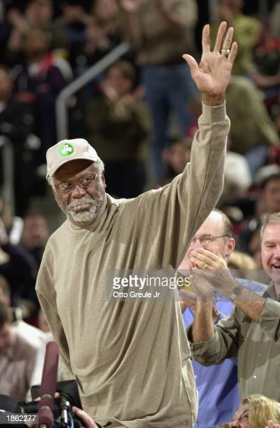 Former Celtic great Bill Russell waves during the game between the Boston Celtics and the Seattle Sonics at Key Arena on February 11 2003 in Seattle...