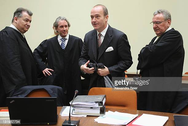 Former CEO of Bayerische Landesbank and Formula One chairman Gerhard Gribkowsky stands next to his lawyers Daniel Amelung Dirk Petri and Rainer...
