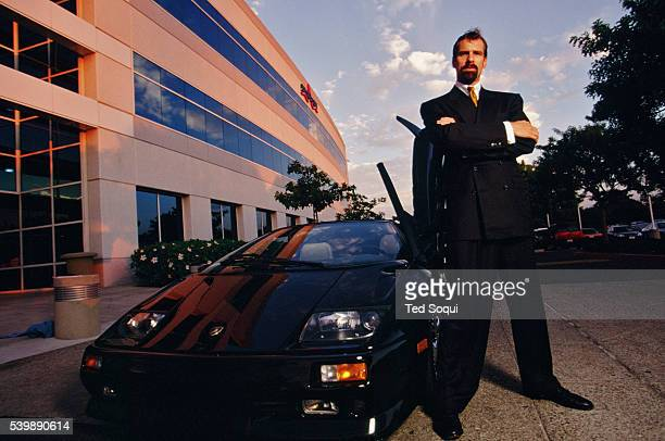 Former CEO of Broadcom Henry T Nicholas stands next to his Lamborghini Diablo at Broadcom headquarters He was indicted by the federal government for...