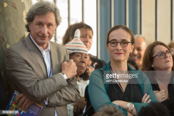 Former CEO of French media group France Televisions Patrick De Carolis and actual CEO of France Televisions Delphine Ernotte attend the official...