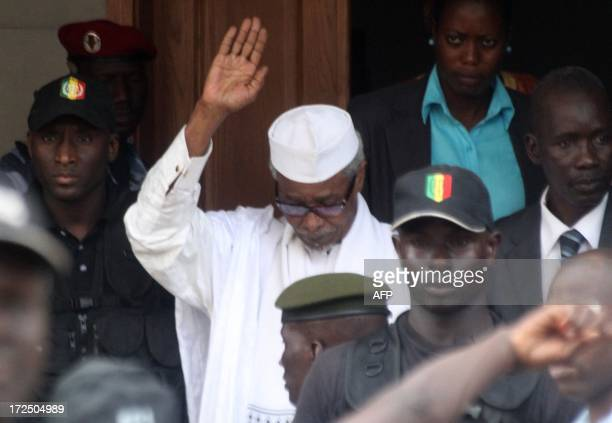 Former Chadian dictator Hissene Habre is escorted by military officers after being heard by a judge on July 2, 2013 in Dakar. Senegalese authorities...