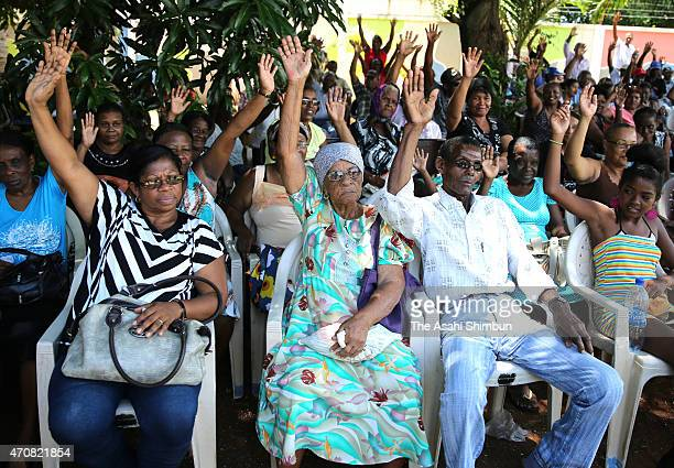 Former Chagos Archipelago inhabitants who was evicted by the United Kingdom government by 1973 raise their hands for demanding the repatriation to...
