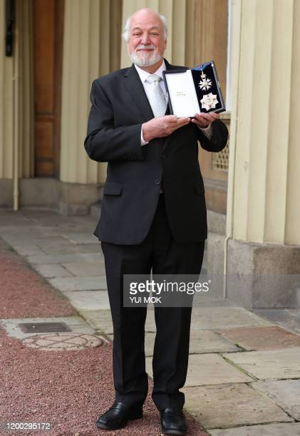 Former chair of the Disasters Emergency Committee Sir Clive Jones poses with his medal after being appointed a Knight Commander of the Order of St...