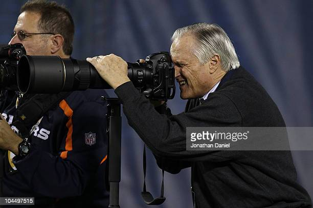 Former Chairman Mike McCaskey takes photographs of the Chicago Bears as they play against the Green Bay Packers at Soldier Field on September 27 2010...