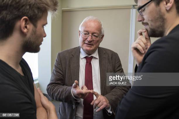 Former Chairman of the chambers of the independent FIFA Ethics Committee HansJoachim Eckert speaks with foreign journalists on May 10 2017 in Manama...