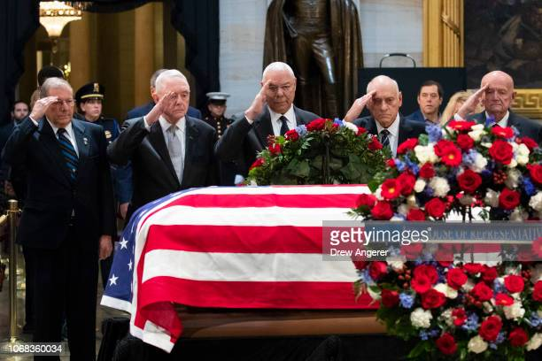 Former Chairman of the Joint Chiefs of Staff and former Secretary of State Colin Powell and former military officials from the Gulf War salute the...