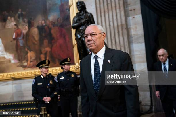 Former Chairman of the Joint Chiefs of Staff and former Secretary of State Colin Powell arrives to pay his respects at the casket of the late former...