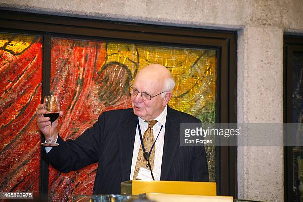 Former Chairman of the US Federal Reserve Paul Volcker raises a glass for a toast from a lectern during a conference of the Group of Thirty hosted by...