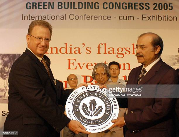 Former chairman of the US Green Building Council JamesEHartzfeld presents the Platinum Green Building Award to ITC Green centre Director SSHRehman as...