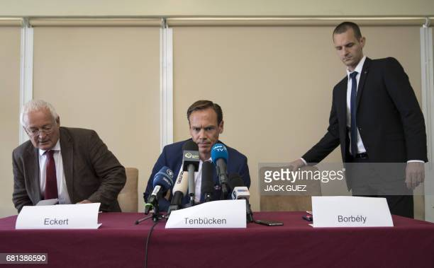 Former Chairmen of the chambers of the independent FIFA Ethics Committee HansJoachim Eckert and Cornel Borbely arrive to give a press conference...