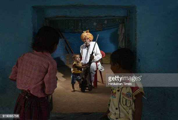 Former Chambal dacoit Munna Singh poses for a portrait as children look on November 7 2018 in Bhind India After serving time in prison he now enjoys...