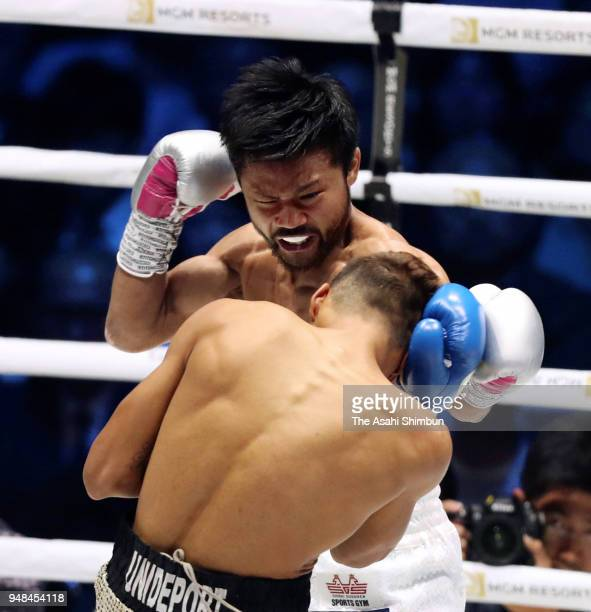 Former champion Daigo Higa of Japan and Challenger Cristofer Rosales of Nicaragua exchange punches in the 1st round during the WBC Flyweight Title...