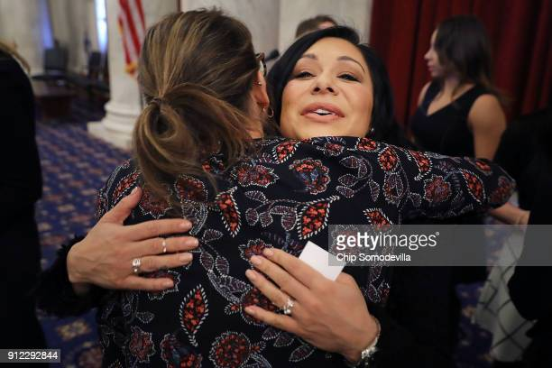 Former champion gymnast Jeanette Antolin embraces a supporter following a news conference with members of Congress in the Russell Senate Office...